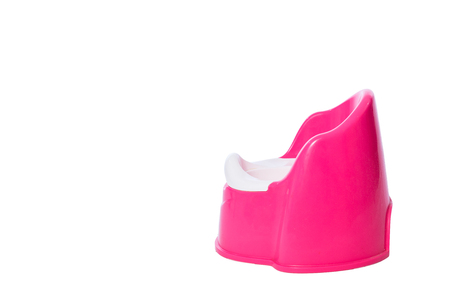 A pink childrens potty in isolated White Background