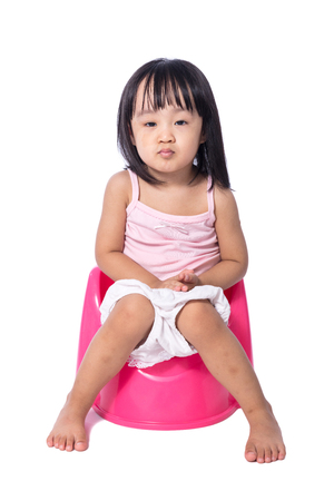 defecate: Asian chinese little girl sitting on chamberpot in isolated White Background