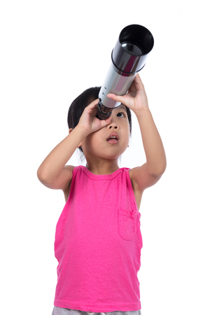 Asian Chinese little girl looking through a telescope in isolated white background