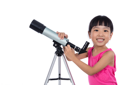 Asian Chinese little girl holding a telescope in isolated white background Stock Photo