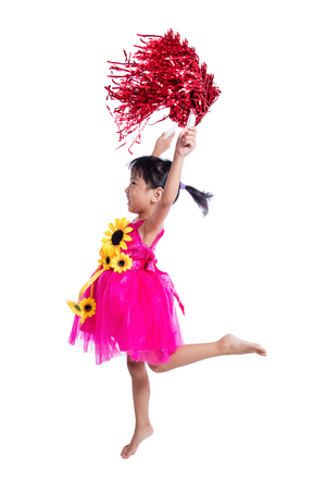 Asian Chinese cheerleader girl holding a pompom in isolated white background