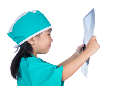 Asian Little Chinese Girl Playing Doctor with stethoscope and x-ray in isolated white background