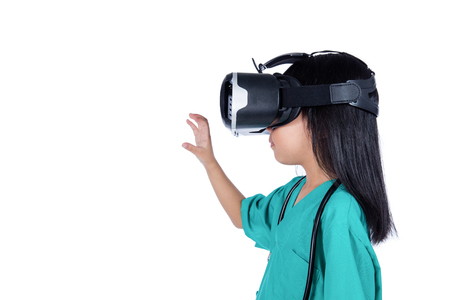 Asian Little Chinese Girl playing doctor with VR goggles in isolated white background Stock Photo