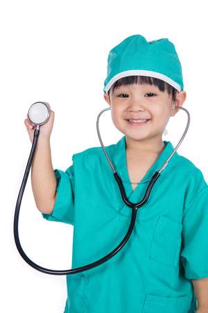 Asian Little Chinese Girl Playing Doctor with a stethoscope in isolated white background Stock Photo