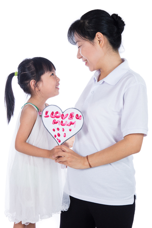 Asian Little Chinese Girl celebrating mothers day with her mom in isolated white background