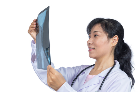 Asian female doctor looking at x-ray image in isolated White Background