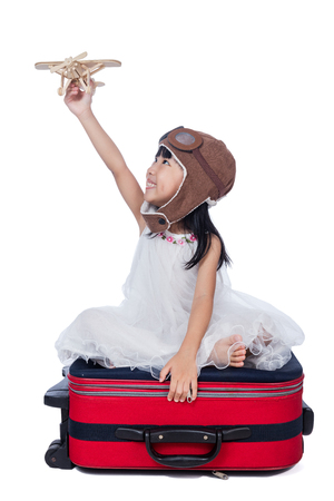 fantasize: Happy Asian Little Chinese girl playing with toy airplane in isolated white background