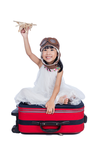 Happy Asian Little Chinese girl playing with toy airplane in isolated white background
