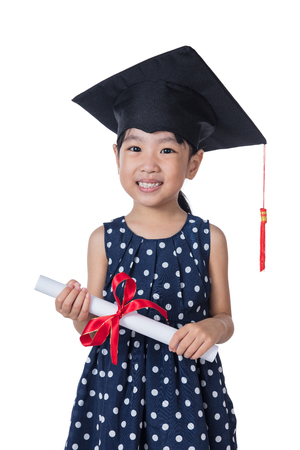 Asian Little Chinese girl wearing graduation cap and holding diploma in isolated white background
