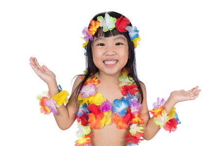 pretending: Asian Chinese little girl in hawaiian costume pretending to be a Hula Dancer in isolated white background Stock Photo