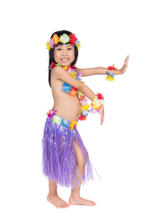ce438ea9f9 Asian Chinese little girl in hawaiian costume pretending to be a Hula  Dancer in isolated white