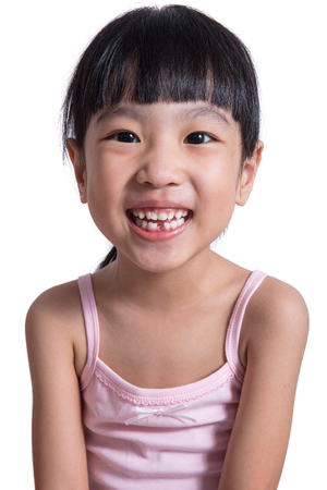 Happy Asian Chinese little girl with toothless smile in isolated white background