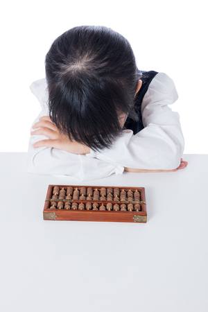 additional training: Asian Chinese little girl playing abacus in isolated white background