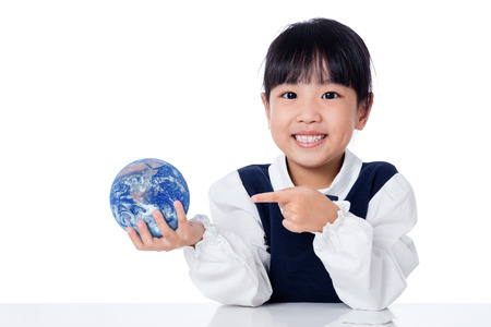 Asian Little Chinese Girl Holding a World Globe in isolated White Background