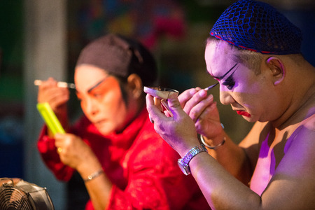 troupe: A group of Chinese Opera member prepares at backstage for a performance in Tanjung Sepat, Selangor, Malaysia on Wednesday, Jul. 19, 2017.   The Opera Group is from Thailand Shengngoy Troupe, they perform the opera in Chinese Teochew dialect.