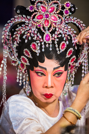 A member of a Chinese Opera group prepares at backstage for a performance in Tanjung Sepat, Selangor, Malaysia on Wednesday, Jul. 19, 2017.   The Opera Group is from Thailand Shengngoy Troupe, they perform the opera in Chinese Teochew dialect.