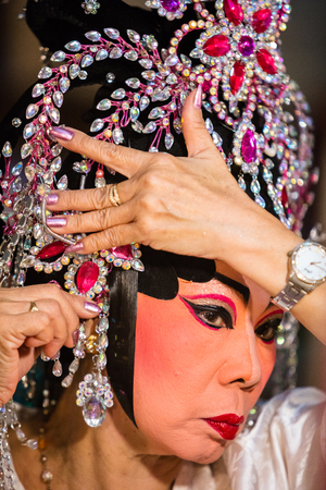 troupe: A member of a Chinese Opera group prepares at backstage for a performance in Tanjung Sepat, Selangor, Malaysia on Wednesday, Jul. 19, 2017.   The Opera Group is from Thailand Shengngoy Troupe, they perform the opera in Chinese Teochew dialect.