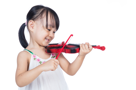 gifted: Asian chinese little girl playing violin in isolated white background