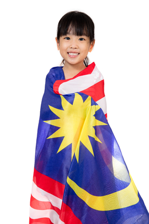 Asian Chinese little girl with Malaysian Flag in isolated white background