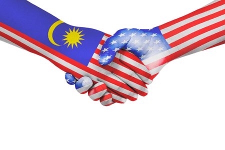 Handshake between Malaysia and United States of America with flags painted on childs hands in isolated white background Stock Photo