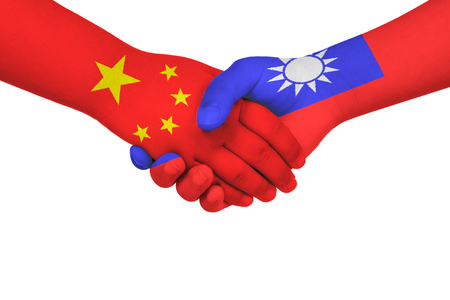 Handshake between China and Taiwan with flags painted on childs hands in isolated white background