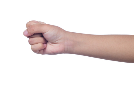 Close up of a child's clenched fist in isolated white background