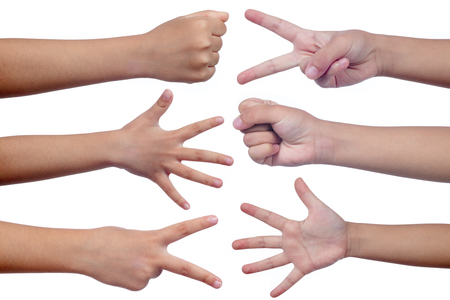 Childs hands making sign as rock paper and scissors in isolated white background