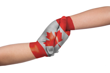 Helping hands of two children with Canada flag painted in isolated white background