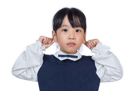 Asian Little Chinese Girl pulling her ears in isolated White Background