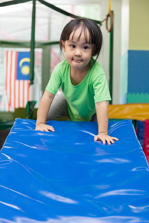 Asian Chinese little girl playing at indoor playground