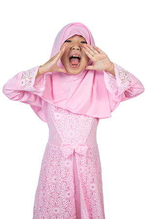 Asian Little Chinese Girl wearing traditional Malay costume in isolated white background