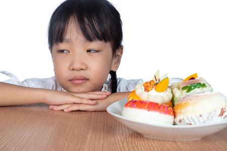 Asian Little Chinese Girl dislike dessert in isolated White Background