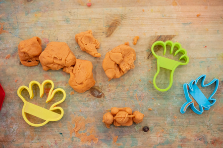 Childrens hands Playing Colorful Clay in Indoor Playground Stock Photo