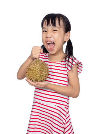 Asian Chinese little girl holding durian fruit in isolated white background