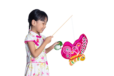 Asian chinese little girl holding latern celebrate mid-autumn festival in isolated white background