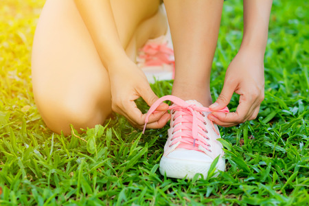 running shoes closeup of woman photo