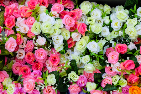 Floral background. Lot of artificial flowers in colorful composition Lizenzfreie Bilder