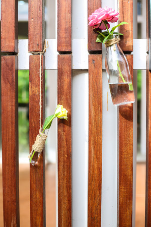 flowerpots: Hanging flowerpots made with glass Bottles in the street.