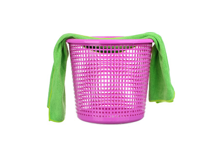 messy clothes: Laundry Basket with colorful towel