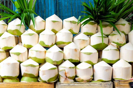 fruit trade: Fresh coconuts in the market Stock Photo
