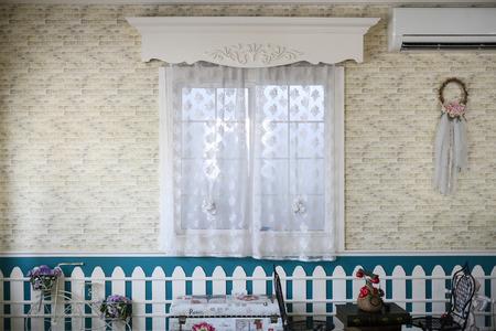 handcarves: curtain through an window