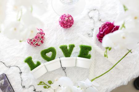 The green  letters on white table Lizenzfreie Bilder