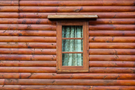 An old weathered window on an abandoned building