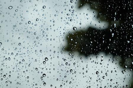 Drops of rain on glass , rain drops on clear window Standard-Bild