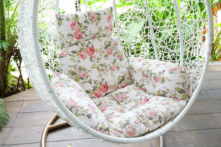 Vintage hanging chair with red seat