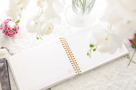 blank notebook on a white wooden table Standard-Bild