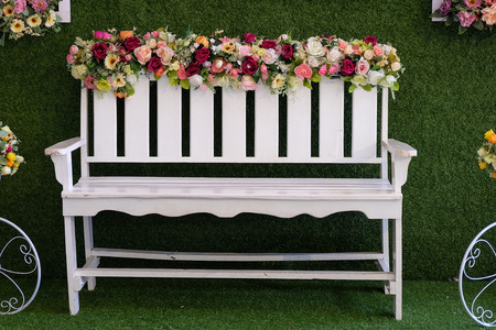 White chairs decorated with flowers
