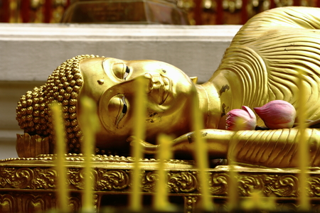 Sleeping Buddha in Thailand with candle photo
