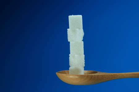 White Sugar on the spoon. photo