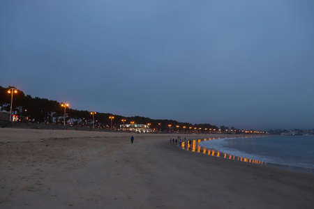Samil beach at dusk, with the reflection of the streetlights
